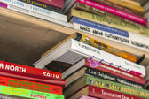 Pile of books in the shop Bookseller — Stock Photo