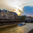Paris, France. View of the embankment of the river Seine at sunset — Stock Photo #46287851