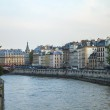 Paris, France. View of the embankment of the river Seine at sunset — Stock Photo #46355785