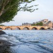 Paris, France. View of the embankment of the river Seine at sunset — Stock Photo #46355819