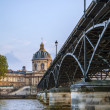 Paris, France. View of the embankment of the river Seine and bridge at sunset — Stock Photo #46355839