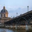 Paris, France. View of the embankment of the river Seine and bridge at sunset — Stock Photo #46355847