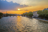 Paris, France. View of the embankment of the river Seine at sunset — Stok fotoğraf