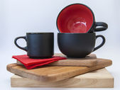 Teacups and saucers graphite gray — Stock Photo