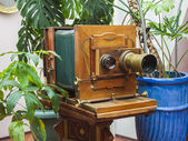 Vintage camera in stylized studio — Stock Photo