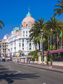 Nice, France, on July 3, 2011. English promenade (Promenade des Anglais) in the sunny day. Promenade des Anglais in Nice - one of the most beautiful and known embankments in Europe — Stock Photo