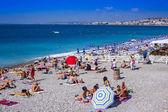 Nice, France, on July 4, 2011. Beach near Promenade d'Angles — Stock Photo