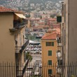 Nice, France, on July 3, 2011. Typical urban view in the summer afternoon. Tourists and citizens go down the street — Stock Photo