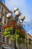 Nice, France, on July 7, 2011. Architectural details. Ancient streetlight — Stock Photo