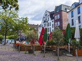 Dusseldorf, Germany, on July 6, 2014. Typical view of the city street. Summer cafe open-air — Stock Photo