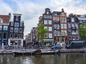 Amsterdam, Netherlands, on July 7, 2014. Typical urban view with old houses on the bank of the channel — Stock Photo