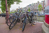 Amsterdam, Netherlands, on July 7, 2014. Bicycle parking on the old narrow city street. — Photo