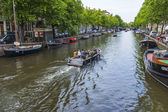 Amsterdam, Netherlands, on July 7, 2014. Typical urban view. Old houses on the bank of the channel — Photo
