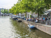 Amsterdam, Netherlands, on July 10, 2014. Typical urban view with old buildings on the bank of the channel — Stock Photo