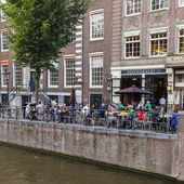 Amsterdam, Netherlands, on July 10, 2014. Typical urban view with old buildings on the bank of the channel — 图库照片