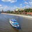 Moscow, Russia, on July 26, 2014. View of the Kremlin and Kremlevskaya Embankment of the Moskva River from Bolshoy Moskvoretsky Bridge — Stock Photo #50506927