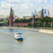 Moscow, Russia, on July 26, 2014. View of the Kremlin and Kremlevskaya Embankment of the Moskva River from Bolshoy Moskvoretsky Bridge — Stock Photo #50507007