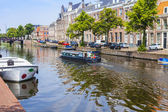 Haarlem, Netherlands, on July 10, 2014. Typical urban view. Old houses in the canal embankment are reflected in its water — Stock Photo