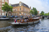 Amsterdam, Netherlands, on July 10, 2014. Walking boat are moving by the channel — Stock Photo