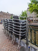 Amsterdam, Netherlands, on July 10, 2014. Typical urban view. Cafe on the embankment — Stock Photo