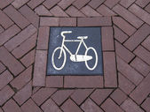 Amsterdam, Netherlands. Path designation for cyclists on the city street — Stock Photo