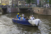 Amsterdam, Netherlands, on July 10, 2014. Walking boat are moving by channel — Stock Photo