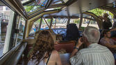 Amsterdam, Netherlands, on July 10, 2014. Tourists sight-see the city from a board of the walking ship — Stock Photo