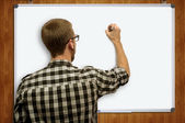 Young Teacher drawing — Stock Photo