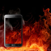 Smartphone with fire buckground — Stock Photo