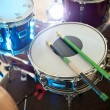 Details of a set of drums on stage, ready for the gig. The drumm - Stock Photo