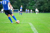 Soccer player kicks the ball. Horizontal image of soccer ball wi — Стоковое фото
