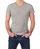 コピー領域の白い背景で隔離された若い男にグレーの t シャツ — ストック写真