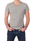 Grey t-shirt on a young man isolated on white background with copy space — Stok fotoğraf