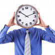 Young businessman with analog clock over his face. Deadline concept isolated on white background. - Stock Photo