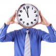 Young businessman with analog clock. Deadline concept. — Stock Photo