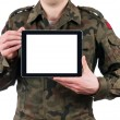 Soldier holding blank digital tablet. clipping path for the screen — Foto Stock