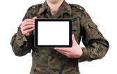 Soldier holding blank digital tablet. clipping path for the screen — Stock Photo