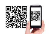 Scanning QR code with smart phone — Stockfoto