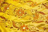 Yellow satin textile — Stock Photo