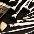 Make-up brushes in dark background — Foto Stock