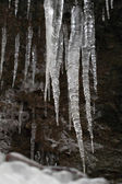 Icicles on dark background — Stock Photo