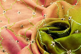 Pink and green satin textile — Stock Photo