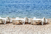 Plastic chairs at a beautiful beach — Stock Photo