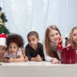 Children holding Christmas gifts — Stock Photo #13451207