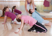 Group of children engaged in physical training indoors. — Stock Photo