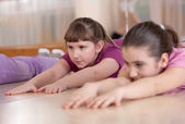 Group of children engaged in physical training indoors. Close-up — Stock Photo