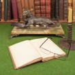 Stock Photo: Antique leather books, lamp and reading glasses on green blotter.
