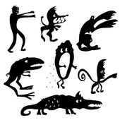 Cartoon monsters silhouettes — Stock Vector