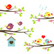 Set of birds on flowering branches — Stock Vector