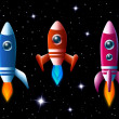 Three brightly colored rockets in outer space — Stock Vector #49579397